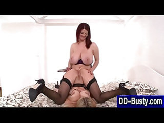 Busty lesbians use dildo to ass toy