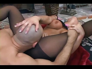 Big boobed brunette fucking in crotchless nylons